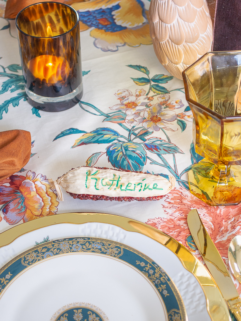 Faux corncob as place card for this intimate and chic Thanksgiving tablescape