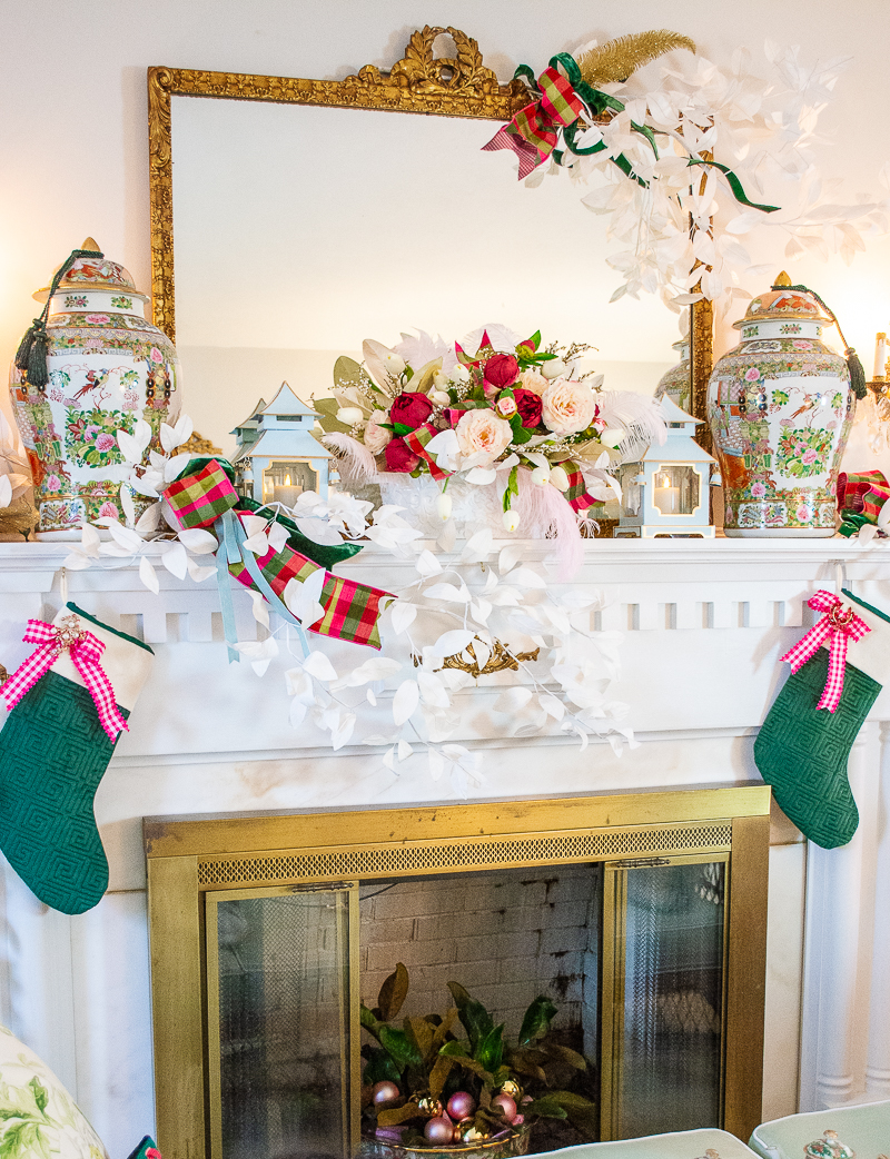 Rose medallion mantel with green stockings, pagoda lanterns, white paper branches, and pink gingham ribbon