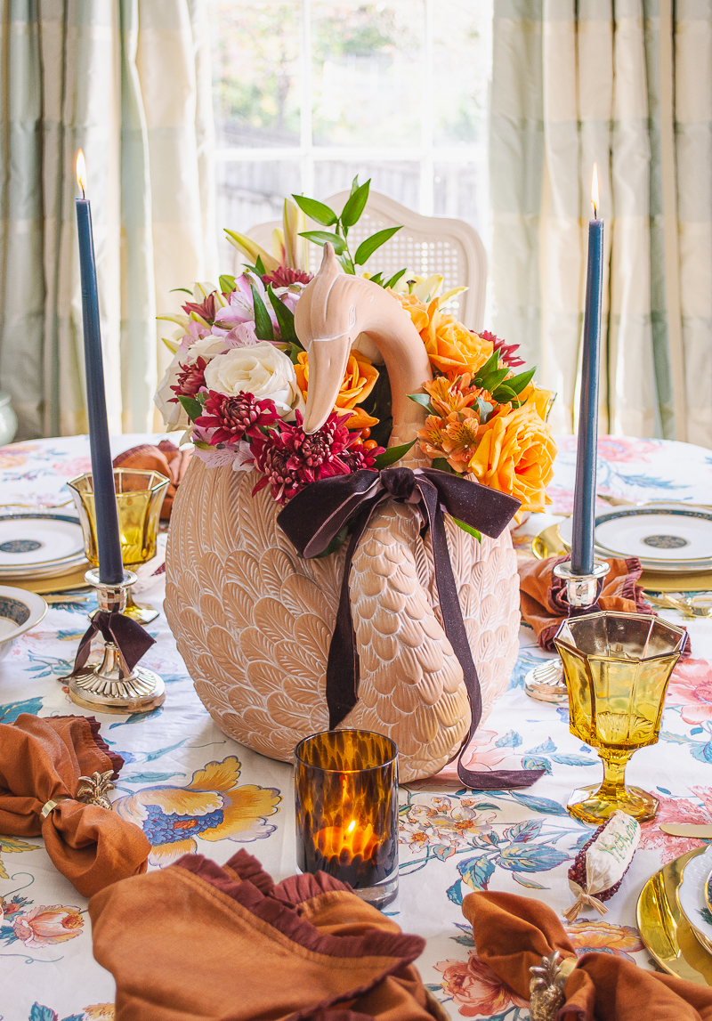 Swan centerpiece with autumn florals and velvet bow