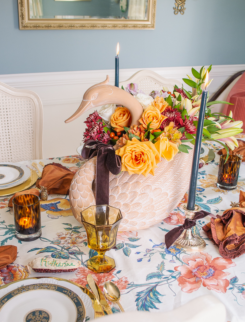 Swan centerpiece with autumn florals floats along on my Thanksgiving Tablescape