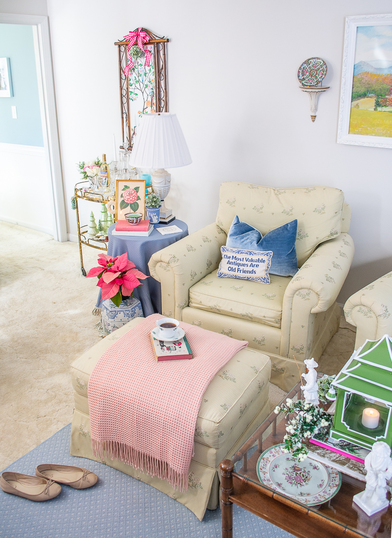 Armchairs in living room with pink poinsettia