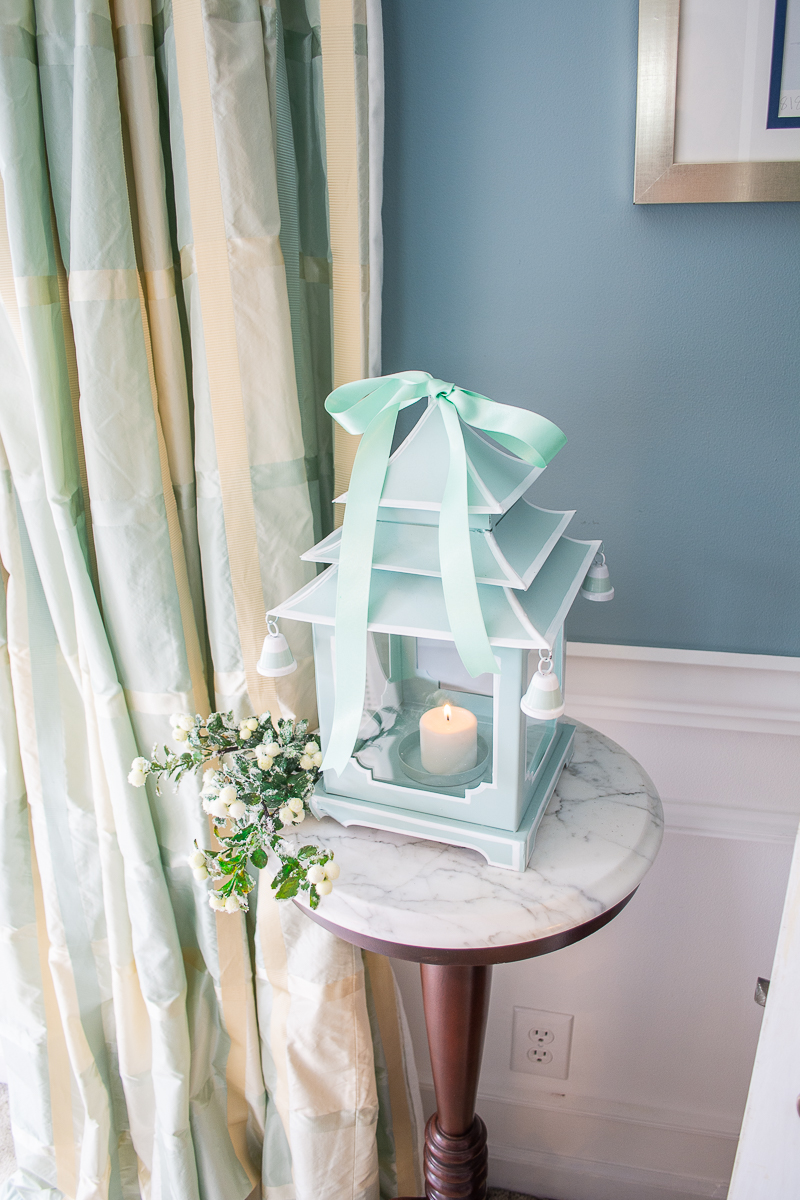 Blue and white pagoda lantern with mint green bow on top