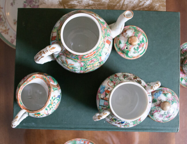 Interior view of antique rose medallion 3 piece tea set with 2 demitasse cups