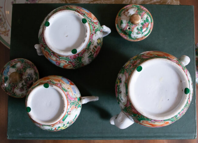 Bottoms of antique rose medallion 3 piece tea set with 2 demitasse cups