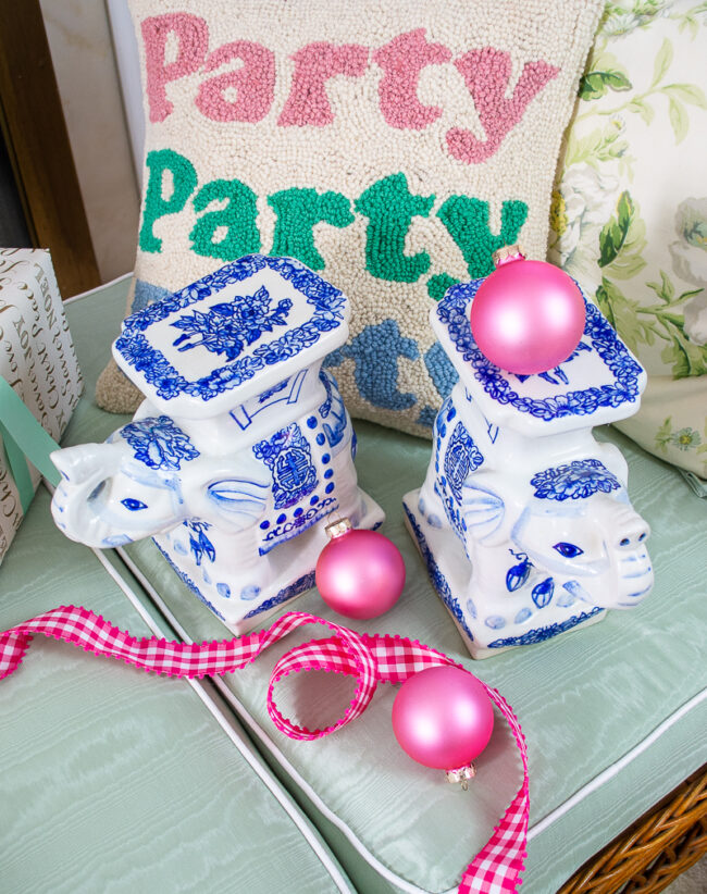 blue and white ceramic elephant stands