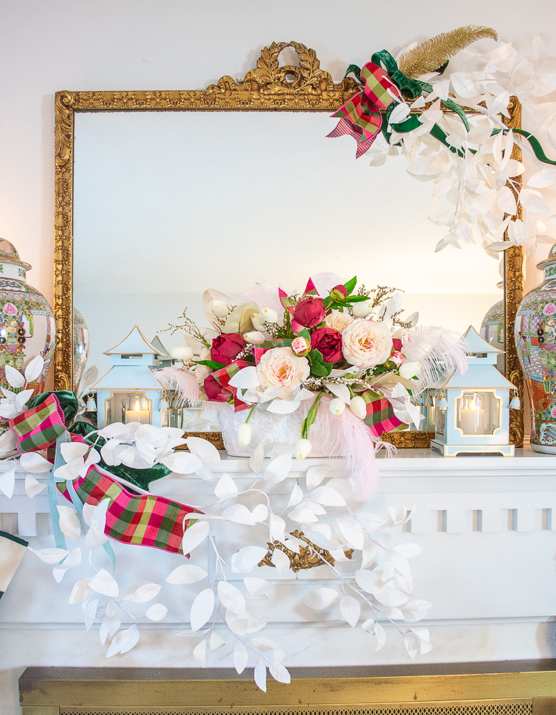 Front view of pink camellia and peony floral arrangement on my Christmas mantel