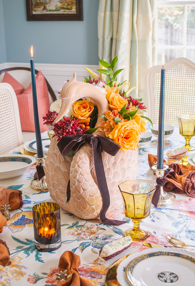 Swan and floral centerpiece on an intimate and chic Thanksgiving table - part of my guide for hosting Thanksgiving during COVID