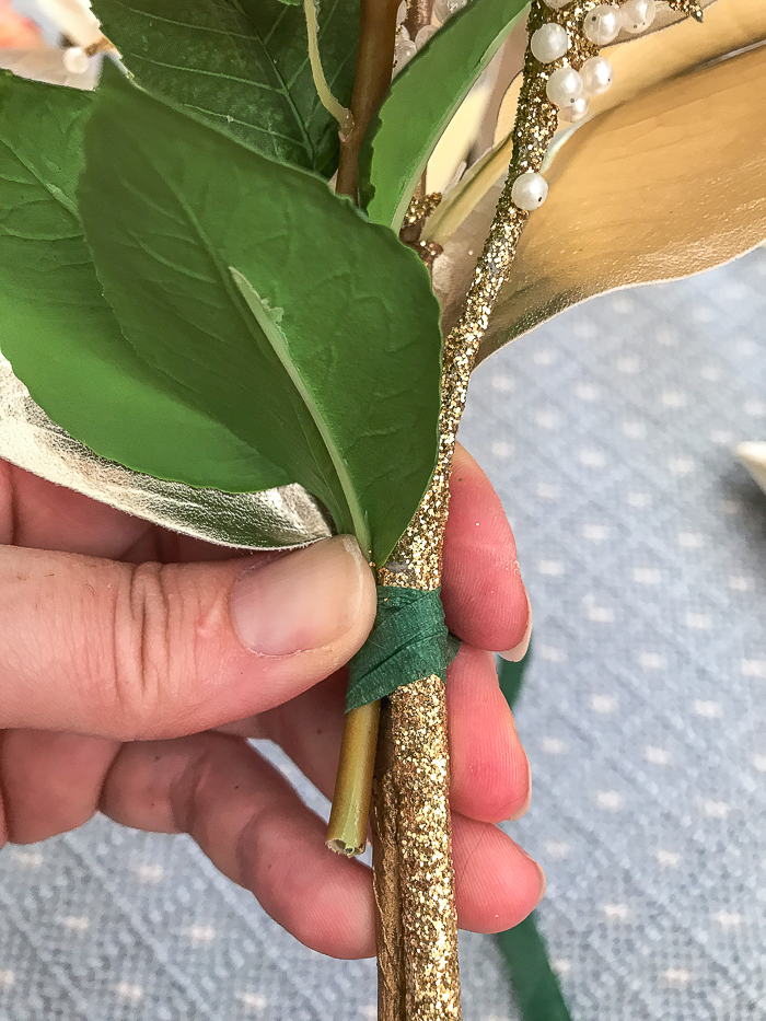 Step No. 2 Start floral tape at base of leaves to hold stems together