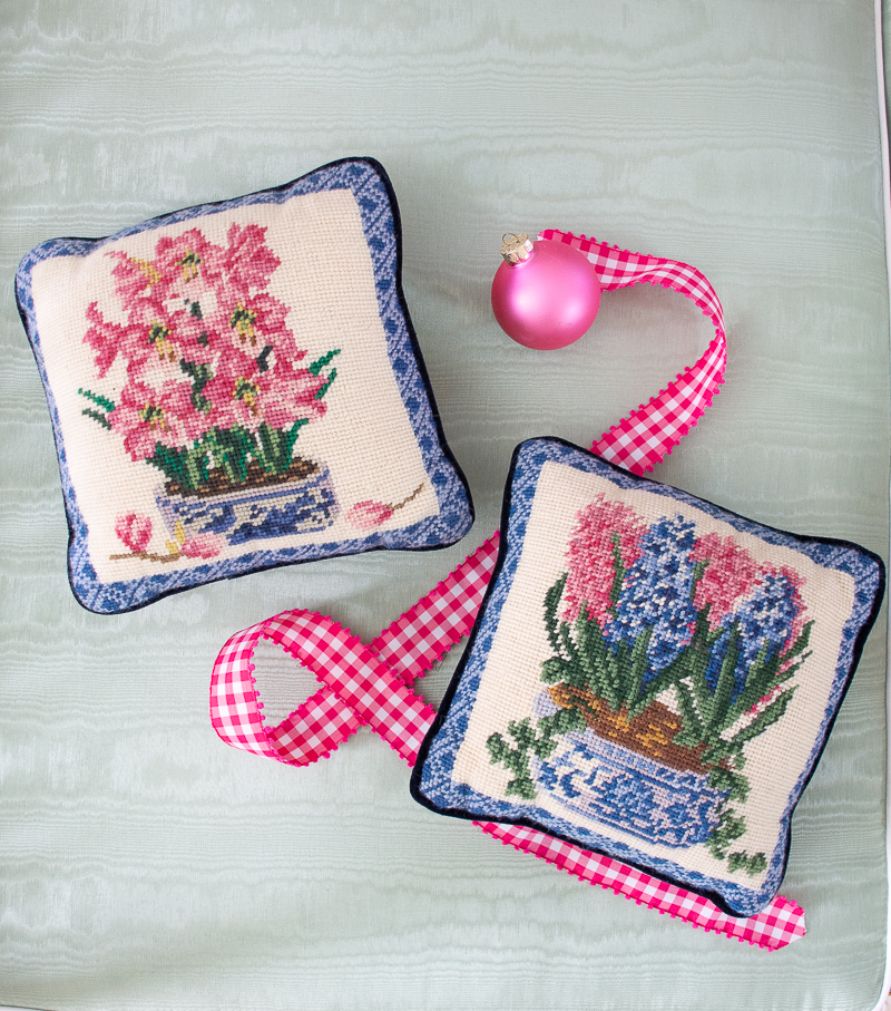 Pair of pink, blue, and white floral needlepoint pillows are a lovely gift for the grandmillennial