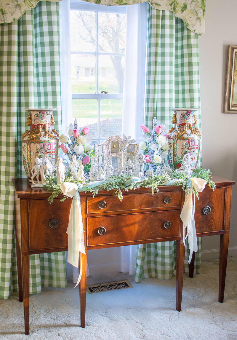 Mahogany sideboard in living room decorated with Nativity scene display for Christmas
