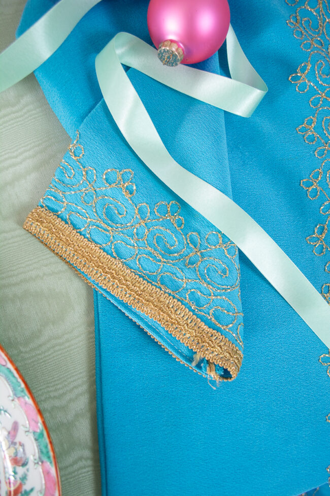 Gold embroidery details on sleeve