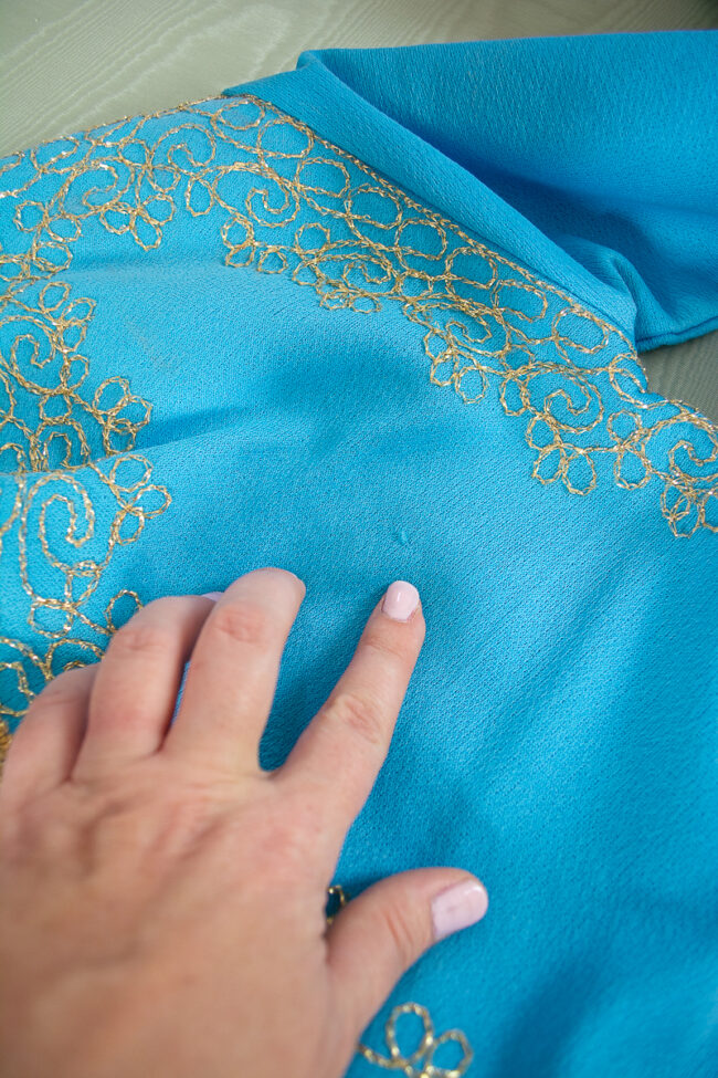 Small pick to fabric on caftan