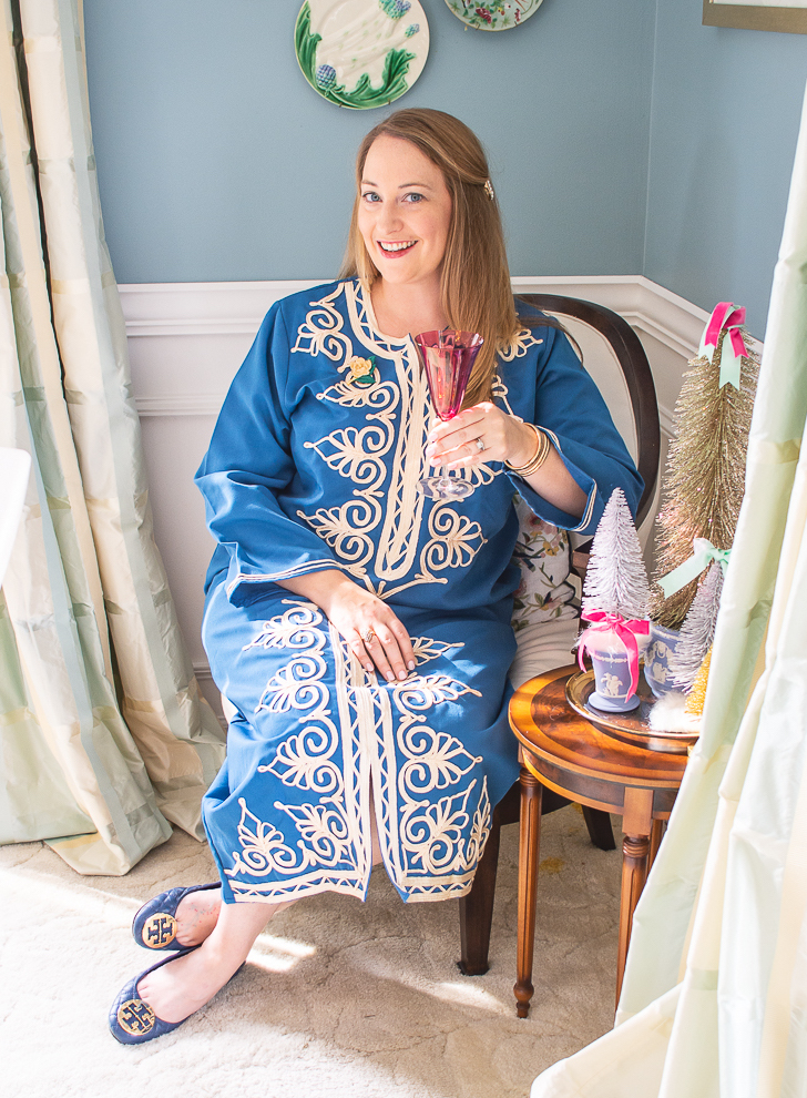 Katherine, the blogger behind Pender & Peony in blue caftan seated in dining room