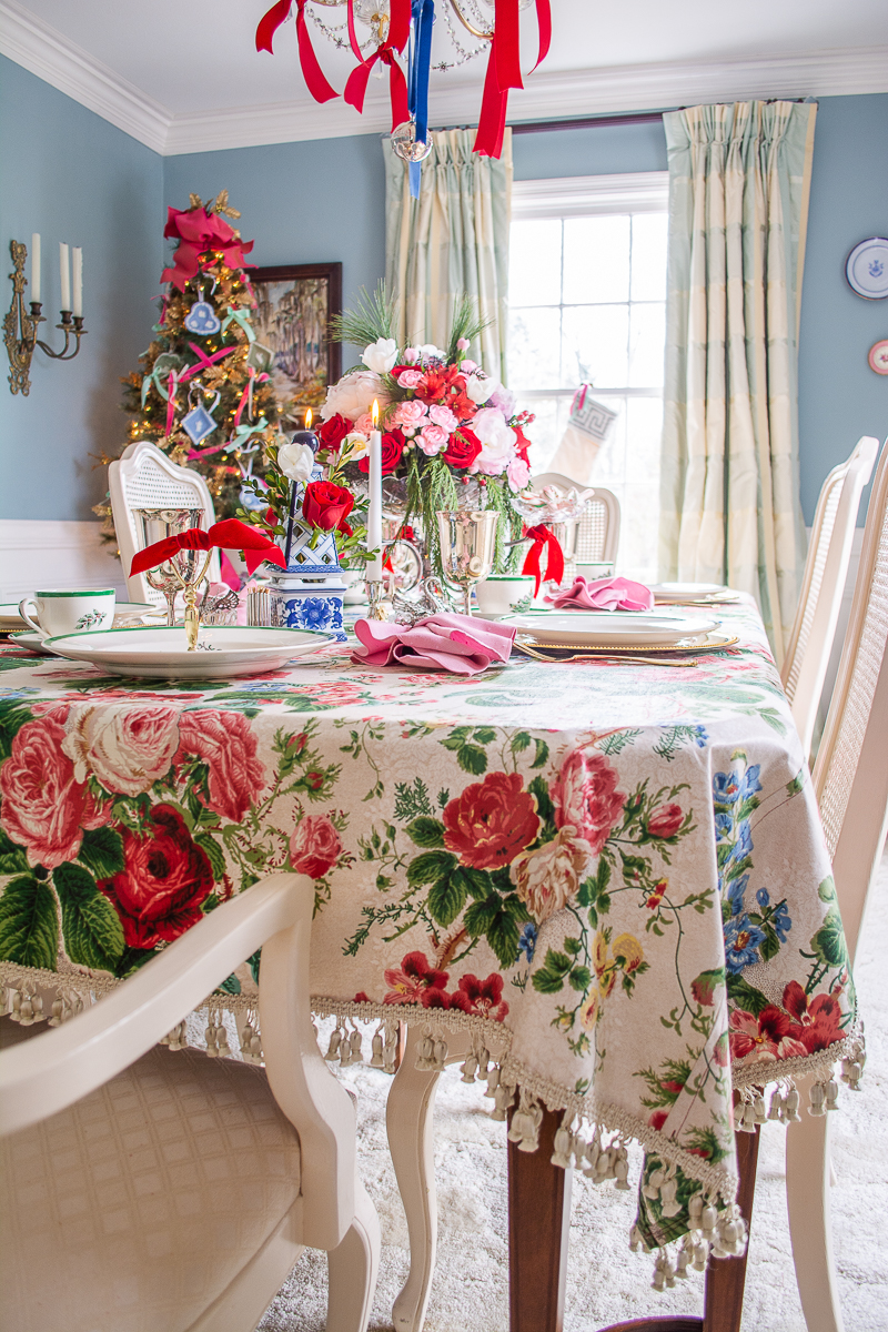 a vintage chintz tablecloth adds a romantic twist to this classic Christmas table
