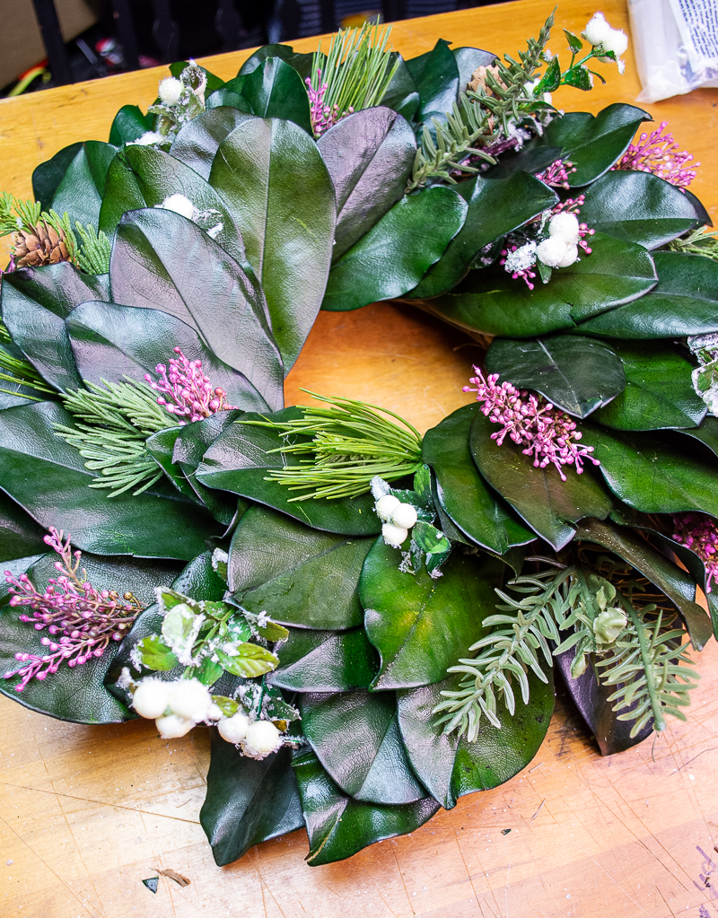 Preserved magnolia wreath with added heather, sugar berries, and evergreen sprigs