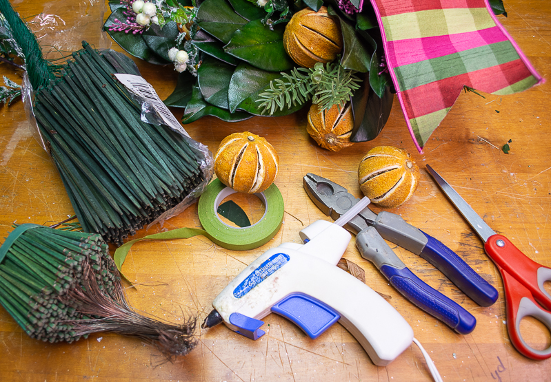 Tools and supplies needed to make Christmas wreaths with dried citrus