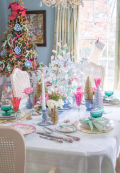 Dreamy pastel Christmas table in Jasperware and jewels with white paper tree centerpiece, Wedgwood vases, pink goblets, green coupes, antique china, and vintage jewelry ornaments