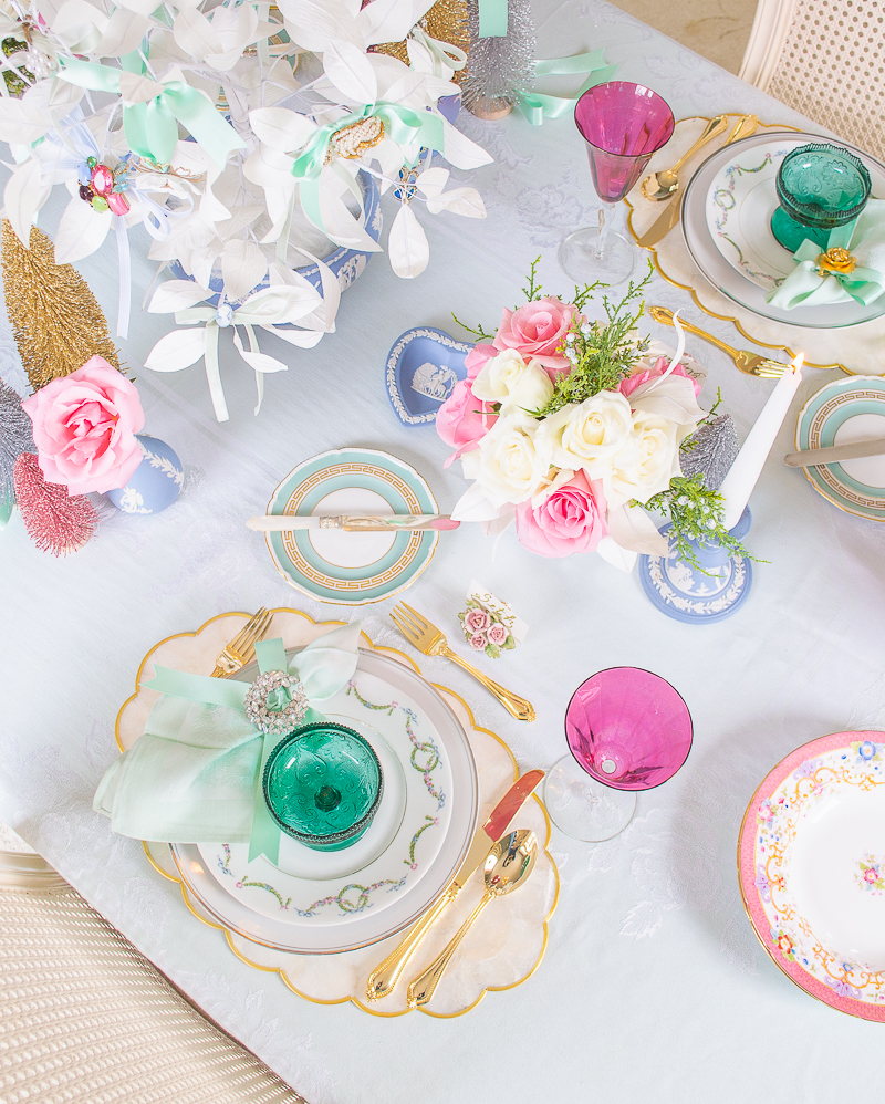 Antique german china, tiara glassware, capiz shell placemats, and vintage jewelry create a dreamy pastel tablescape for Christmas