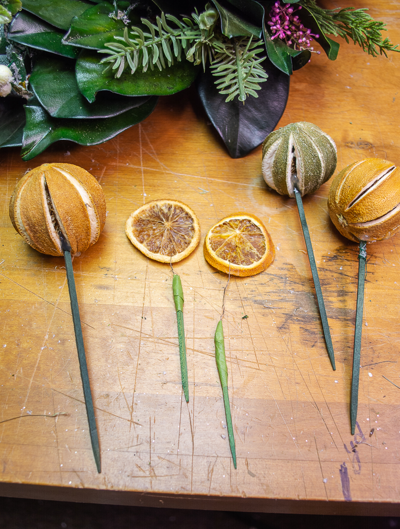 Several citrus slice picks and pomander picks ready to add to wreath