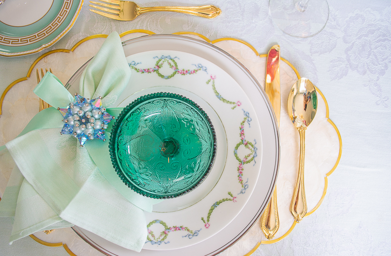 detail view of place setting with vintage brooch napkin ring