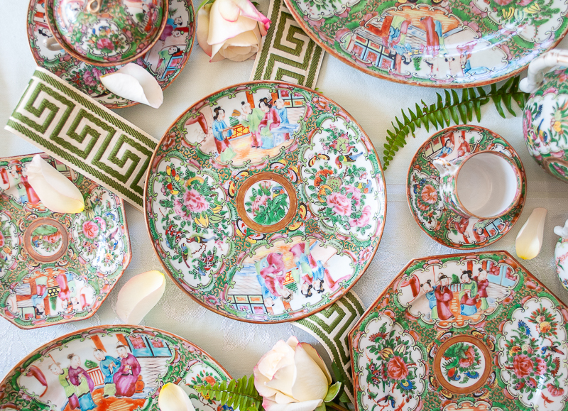 Flat lay of Rose Medallion plates and cups showing differences in designs internal in understanding Rose Medallion 101