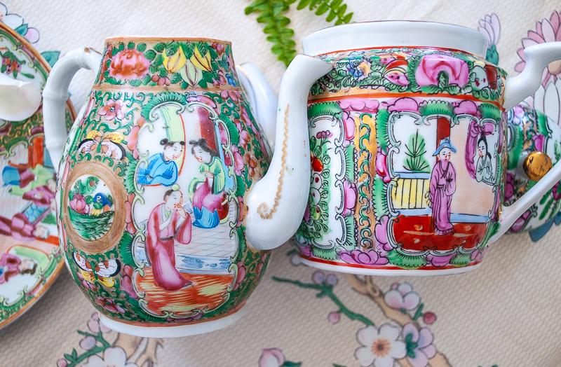 Two teapots - one 19th century and the other 20th century show differences in enamel color over time