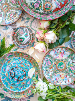 Flat lay image of various Famille Rose porcelains from the Chinese export market, featuring Rose Medallion