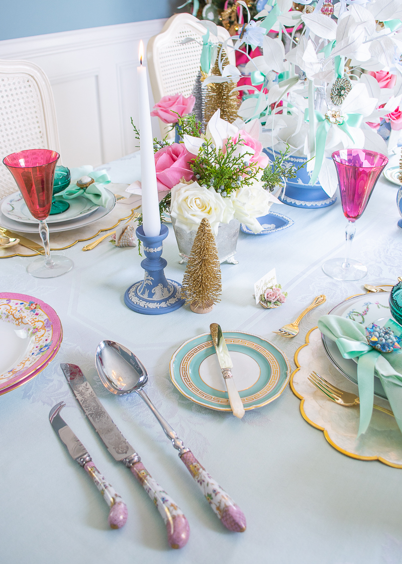 Side view of vintage and antique tableware on dreamy pastel Christmas tablescape