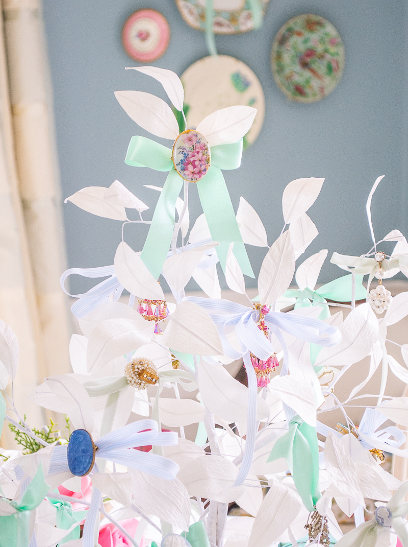 White winter paper tree topped with Limoges floral brooch