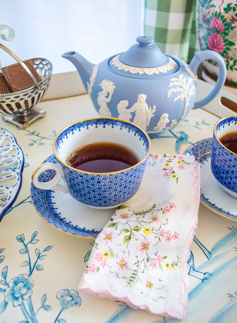 Blue Lace Mottahedeh tea cup with vintage hankie napkin and teapot in background
