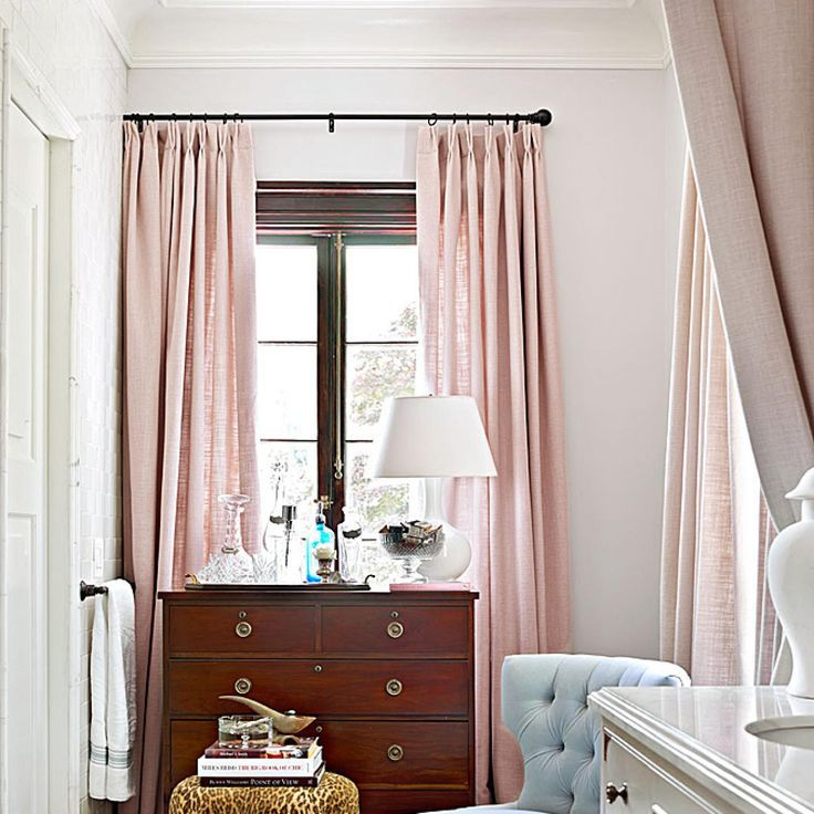Dressing room with pale pink curtains