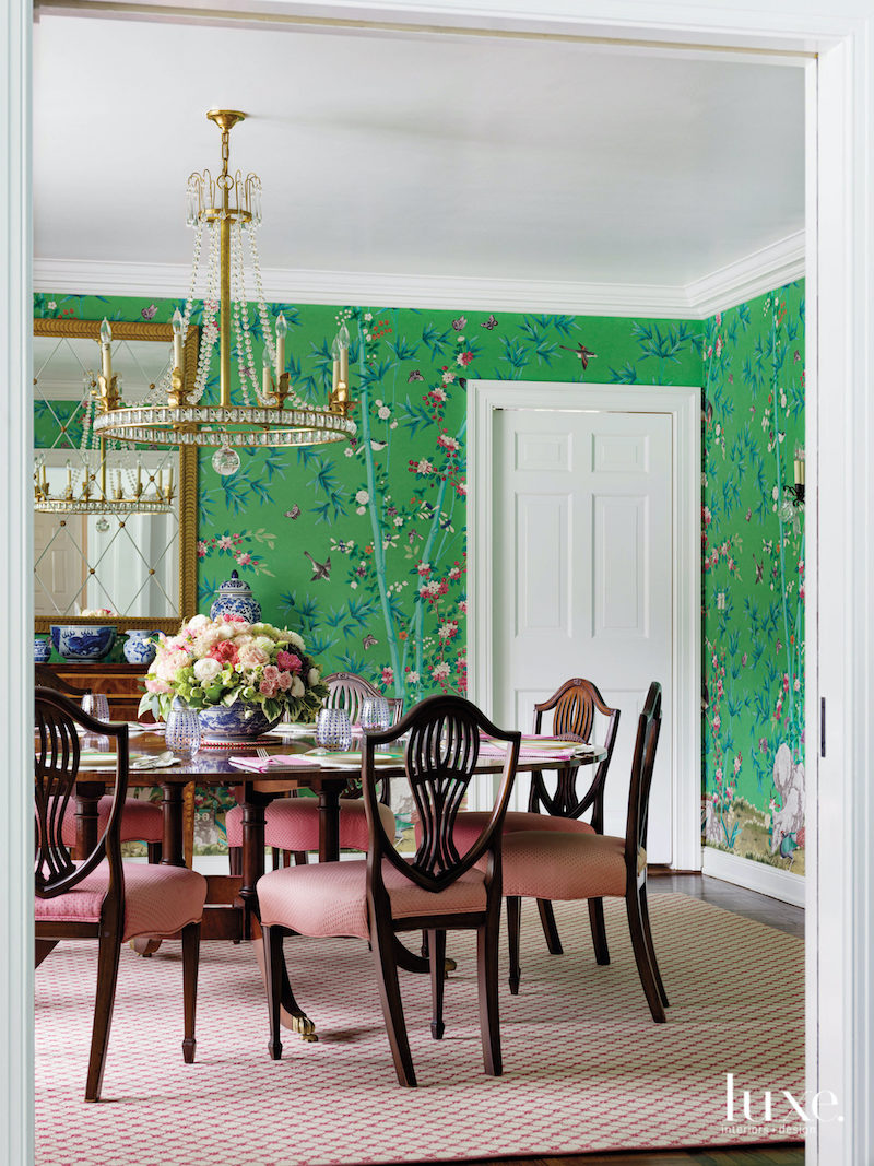 Green chinoiserie dining room with pink upholstery in this Shelley Johnstone designed room