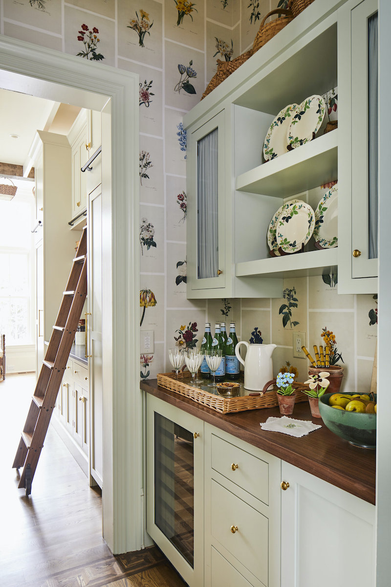 Butler's pantry in pale green with botanical wallpaper