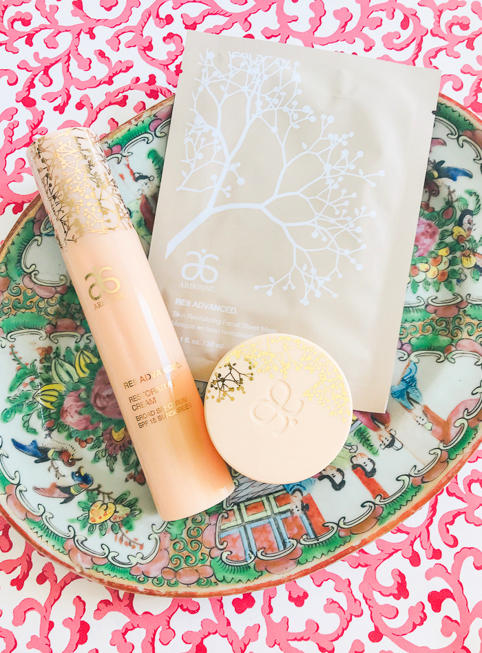 Arbonne products part of my winter skin care routine laid on Rose Medallion plate with pink background