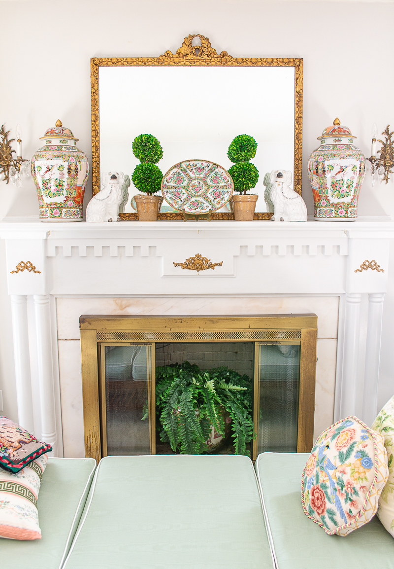 Decorate with green tip no. 4 is partner gilt and green for example the green boxwood topiaries and gilt laurel mirror on the mantel