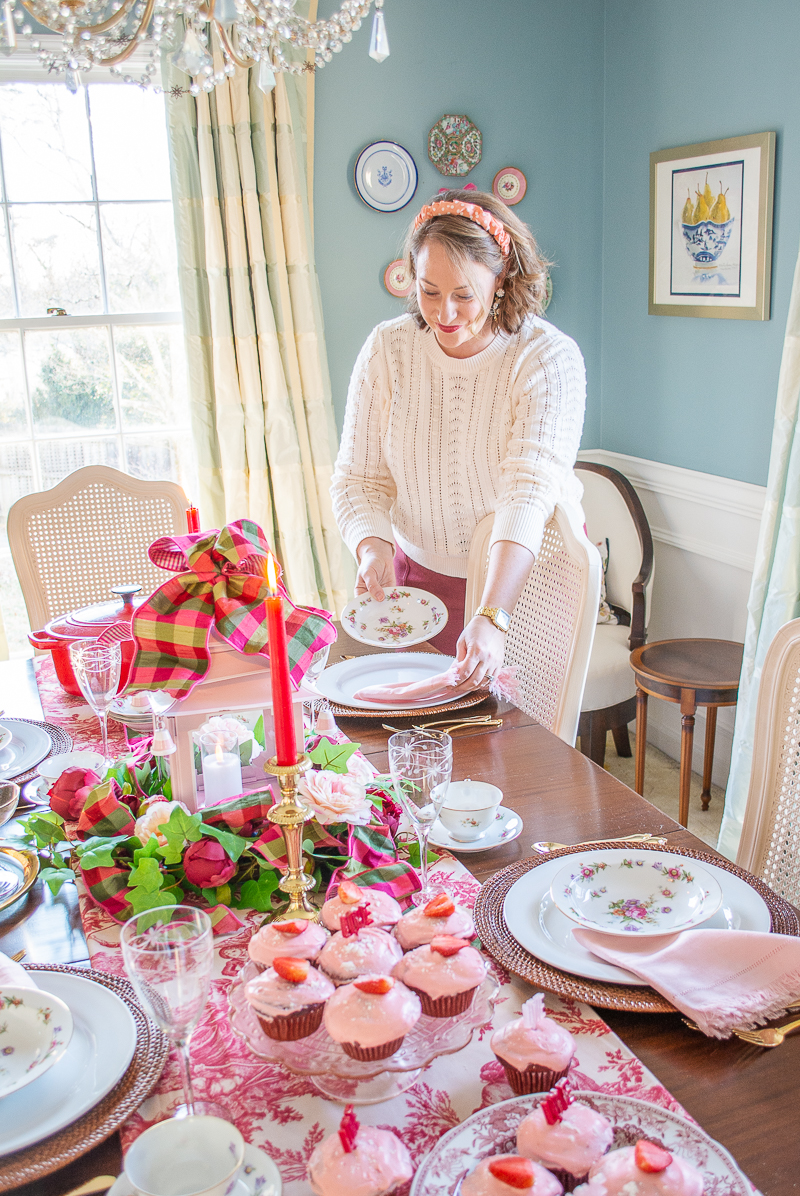 Katherine sets A love & toil tablescape for Valentine's day, mixing red toile runner with faux floral centerpiece, pink pagoda lantern, and Dresdenia china