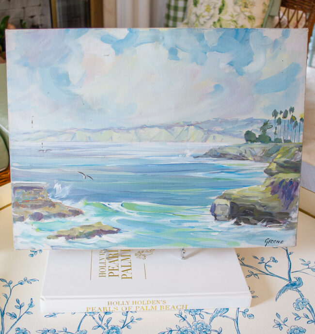 Seascape painting with coast line visible and gulls
