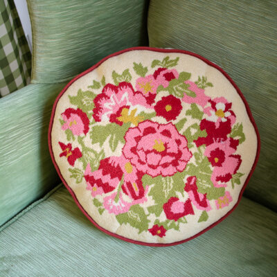 pink and red floral needlepoint pillow