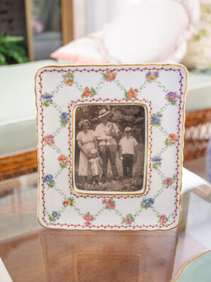 Ceramic floral frame holds family photo of Katherine's grandparents