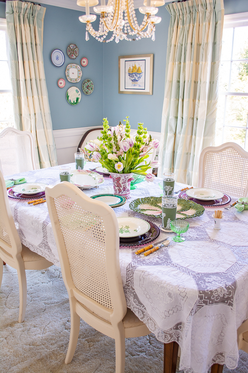 Springtime table in green and white with Wedgwood Patrician dishes, cabbage ware, and floral bouquet of tulips, bells of Ireland, and calla lillies