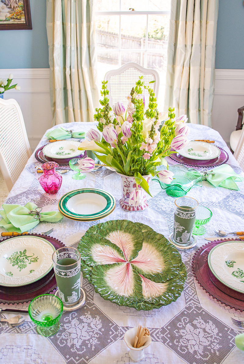Straight on view of entire green and white tablescape perfect for spring meals