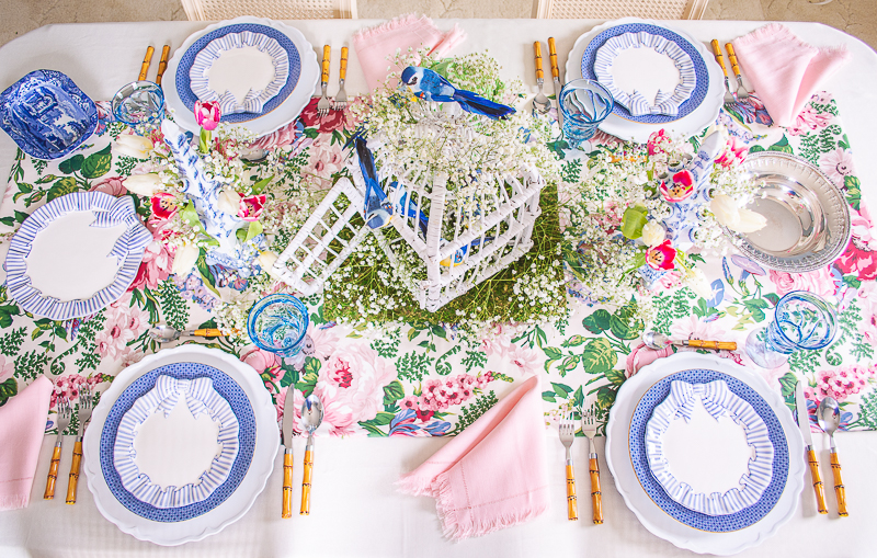 Baby's breath, songbird and tulipiere spring centerpiece shine on this whimsical spring tablescape