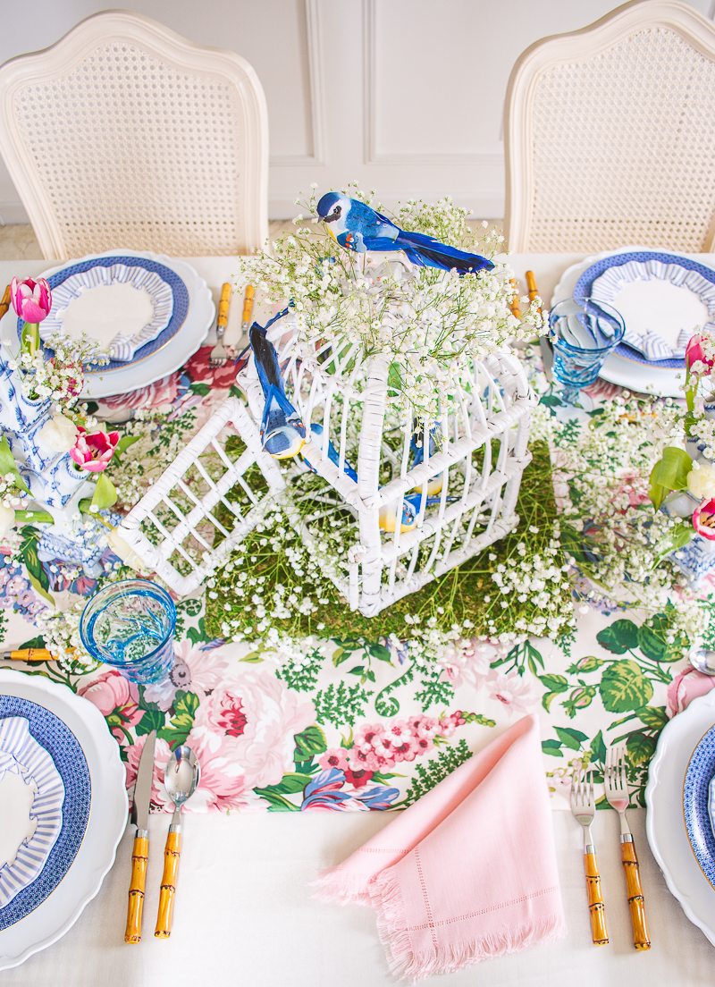 Wicker bird cage with baby's breath and blue songbirds