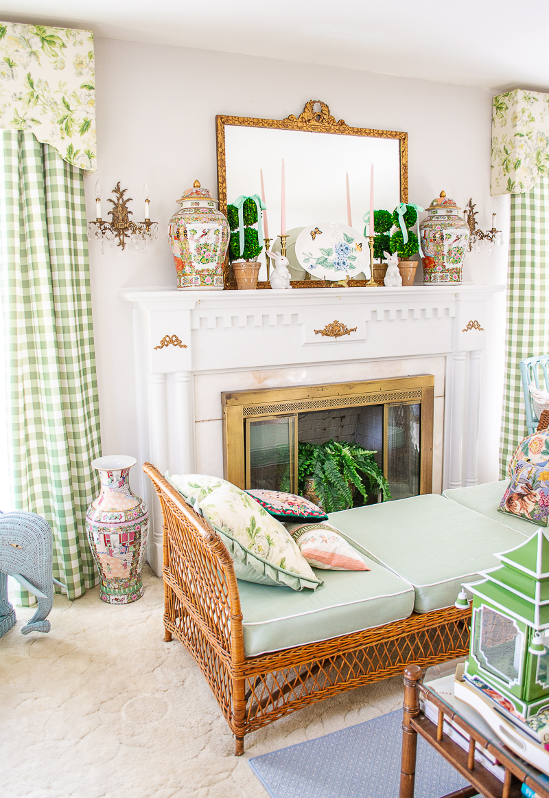 Spring mantel in Katherine's grandmillennial living room with boxwood topiaries, mint green bows, white bunnies, and Lenox butterfly meadow platter