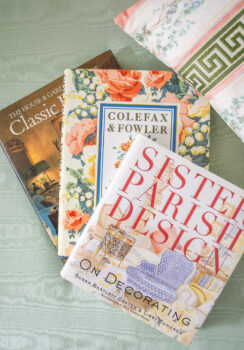 Stack of design books on traditional designers: Sister Parish, Colefax & Fowler, and Classic Interiors