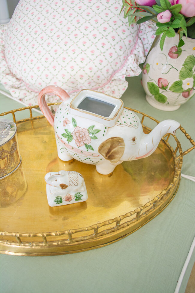 Ceramic elephant and baby teapot in white, pink, and green