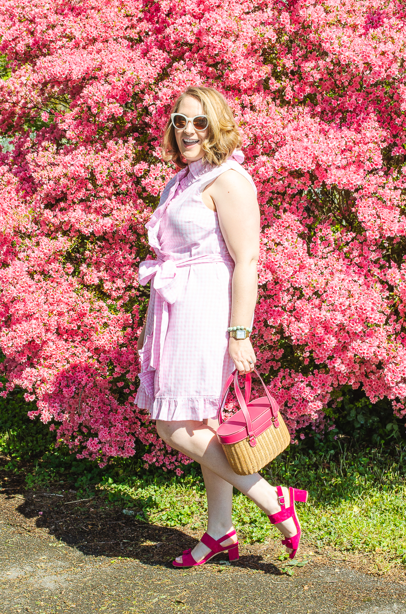 Katherine in pink gingham dress in front of blooming azalea