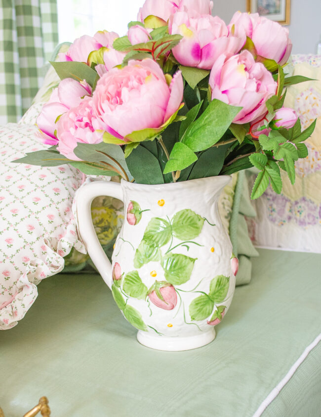 Vintage white, pink, and green strawberry pitcher with pink faux peony arrangement