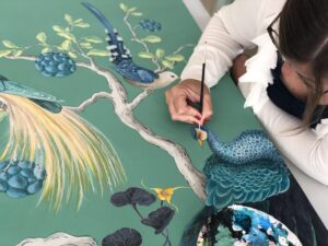 Allison Cosmos working on a painting
