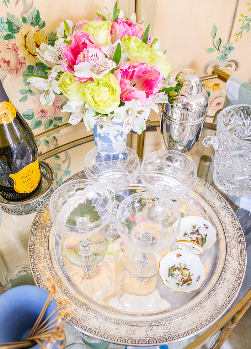 Etched floral coupes are a chic choice for a vintage bar cart